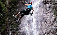 Rappel down four tropical waterfalls